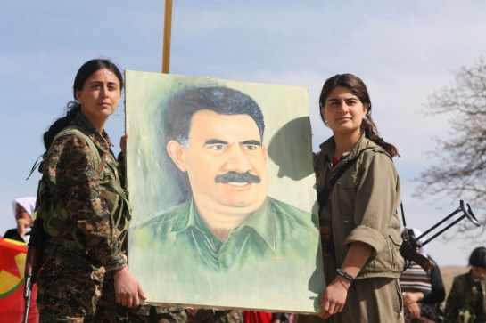 YBS_and_PKK_fighters_holding_up_a_painting_of_Abdullah_Öcalan