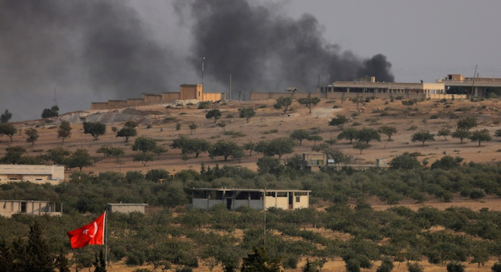 Smoke rises from the Syrian border town of Jarablus as it is pictured from the Turkish town of Karkamis, in the southeastern Gaziantep province