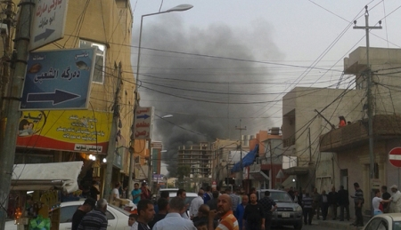 Smoke rises from the site of a bomb attack in Erbil, the capital of Iraq's Kurdistan region, April 17, 2015.  A car bomb exploded on a road outside the U.S. Consulate and compound in Erbil on Friday, a Reuters witness said. The consulate houses U.S. diplomats and staff but there was no immediate reports of casualties. Gunfire was heard immediately after the blast but stopped later, the witness said. REUTERS/Stringer - RTR4XRWU