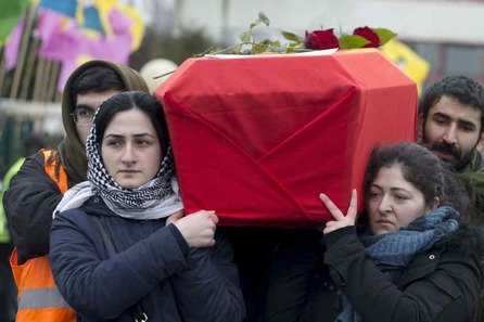 Kurds people carry the coffin of one of the three top Kurdish activists from a separatist group banned in Turkey shot dead four days ago in the French capital, on January 15, 2013 in Villiers-le-Bel, outside Paris, during a rally to pay tribute to them.  Kurdish activists have accused Turkey in the deaths of the three activists Sakine Cansiz, Fidan Dogan and Leyla Soylemez. AFP PHOTO/JOEL SAGET
