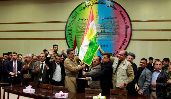 Kurdish parties raise the Kurdish flag at the Kirkuk Governorate Council in Kirkuk