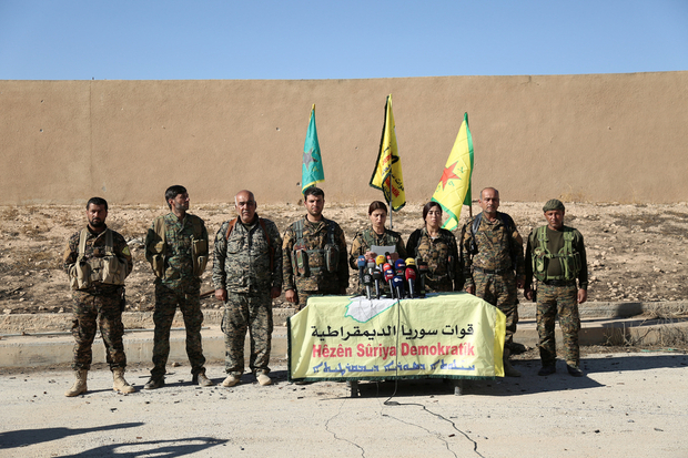 Syrian Democratic Forces commanders attend a news conference in Ain Issa