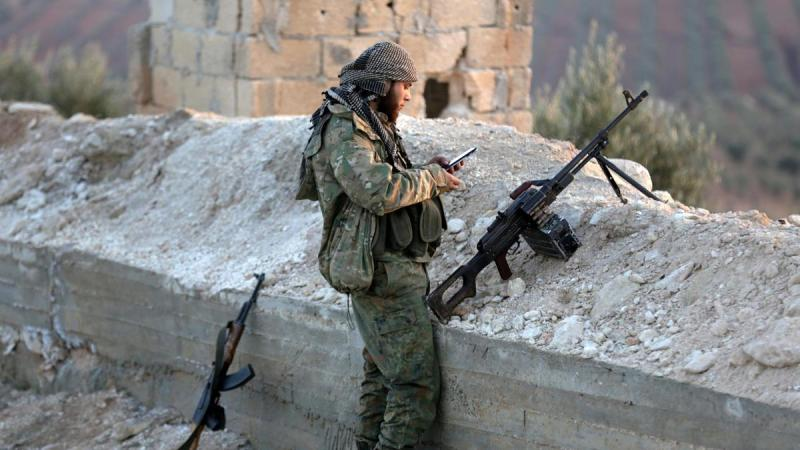 A-Turkish-backed-Free-Syrian-Army-fighter-checks-his-mobile-phone-in-Eastern-Afrin-countryside