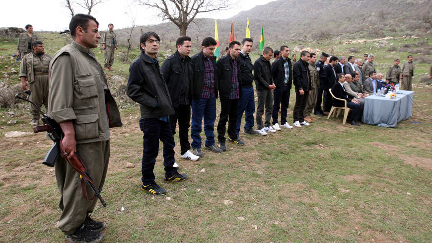 The eight Turkish prisoners are seen as they are released in the northern Iraqi city of Dohuk